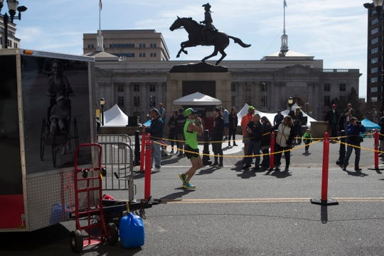 Runners compete in the 56th annual Caesar Rodney Half-Marathon Sunday morning in downtown Wilmington