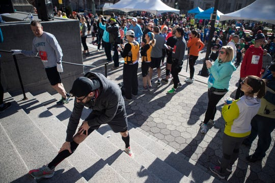 Runners prepare before the start of the 56th annual Caesar Rodney Half-Marathon Sunday morning in downtown Wilmington.