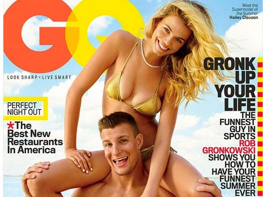 May 12, 2016: Rob Gronkowski is pictured with Sports Illustrated swimsuit model Hailey Clauson on the cover of GQ magazine.