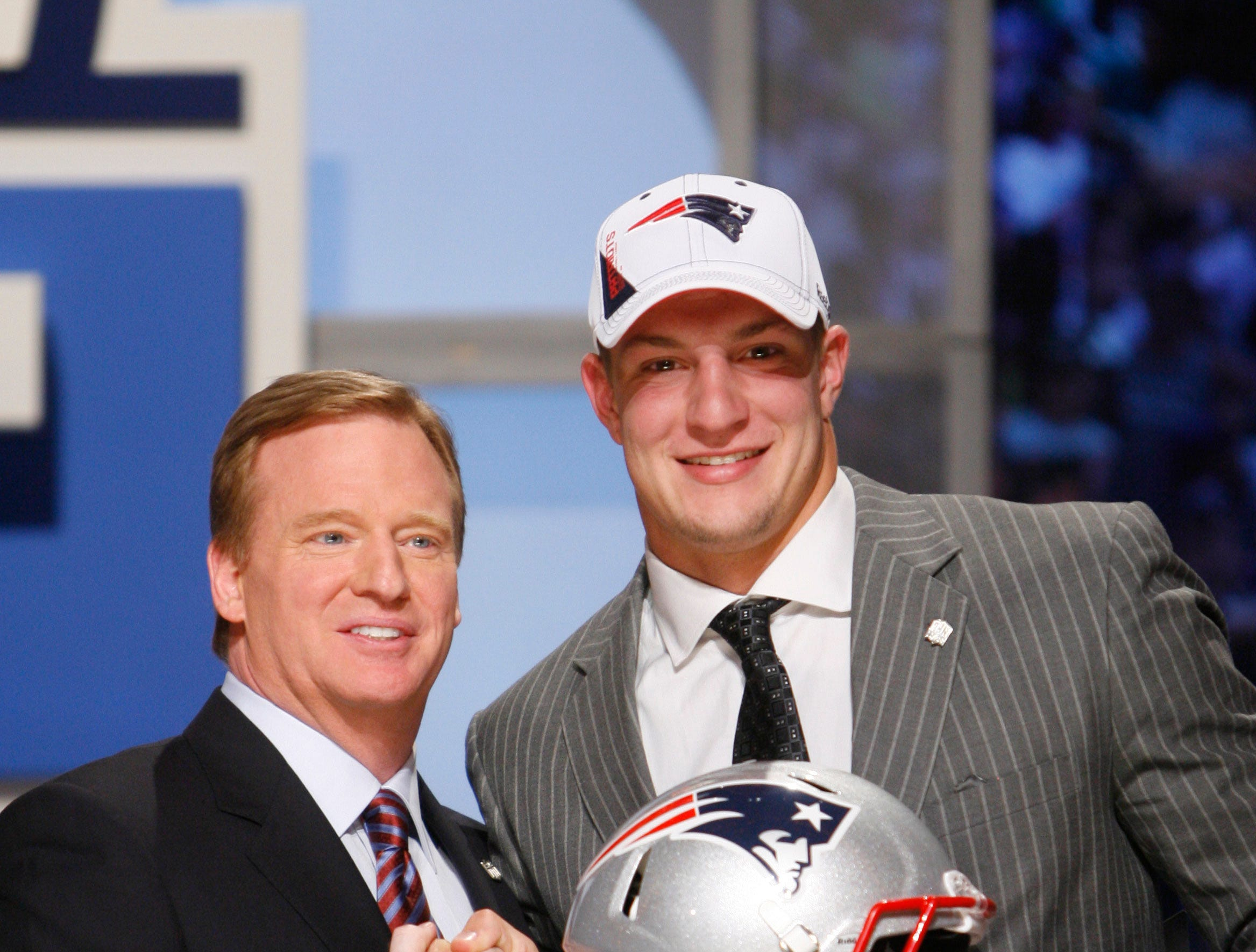 April 23, 2010: Rob Gronkowski smiles while posing for photographs with NFL commissioner Roger Goodell after he was selected as the 42nd overall pick by the New England Patriots in the second round of the draft at Radio City Music Hall.