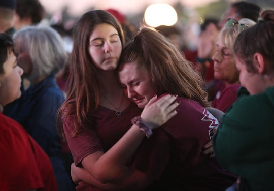 People attend a memorial service on February 14, 2019 in Parkland,  Florida, to mark the first anniversary of the mass shooting at Marjory Stoneman Douglas High School.