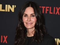 Courteney Cox defies gravity in epic poolside video