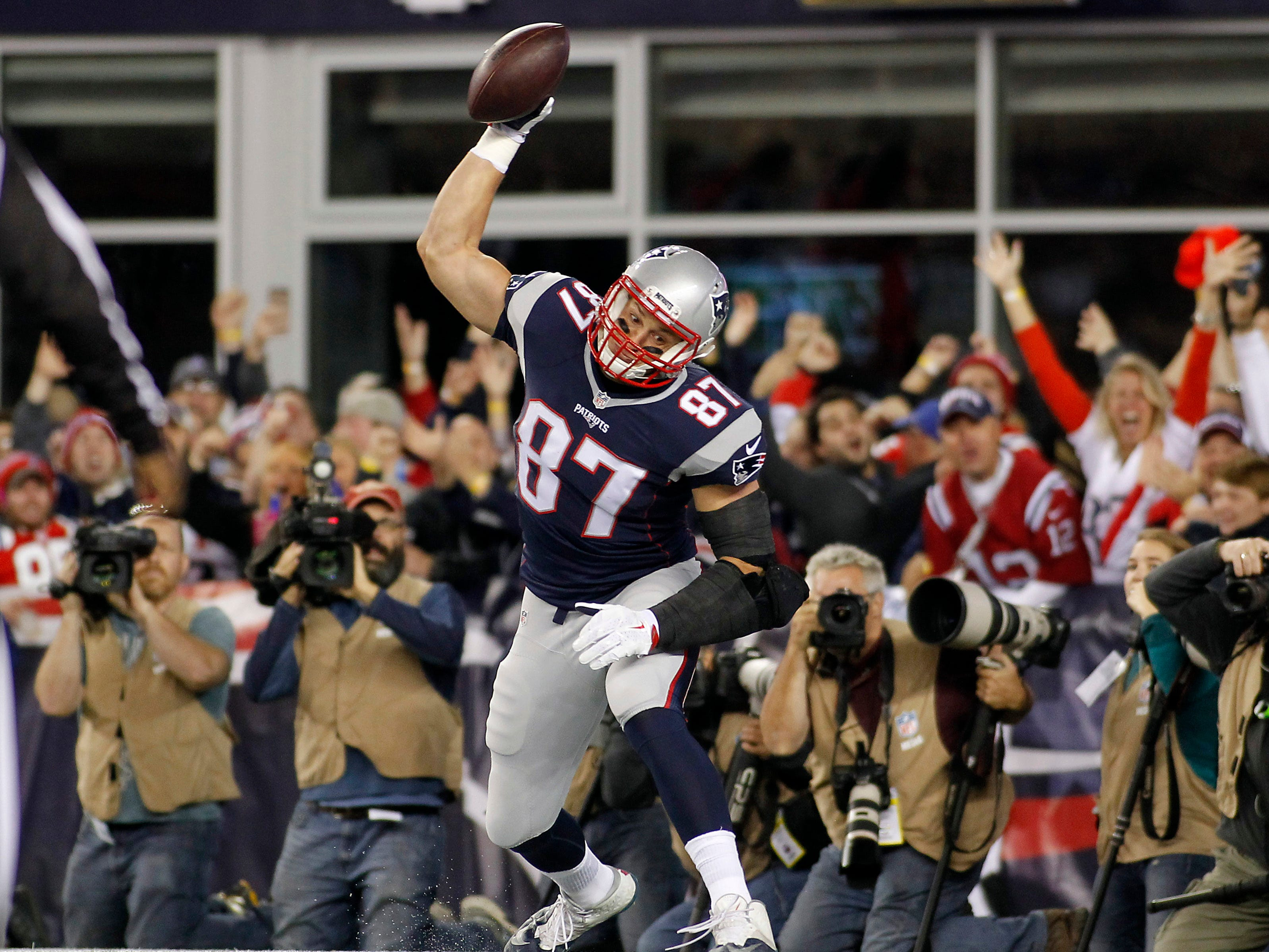 Oct. 29, 2015: Rob Gronkowski spikes the ball after scoring a touchdown against the Miami Dolphins during the first quarter at Gillette Stadium.