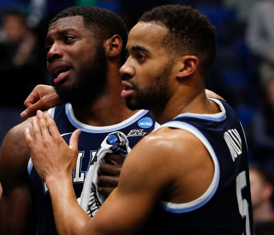 Villanova's Phil Booth, right, hugs teammate Eric Paschall after a loss to Purdue in the second round of the NCAA tournament.