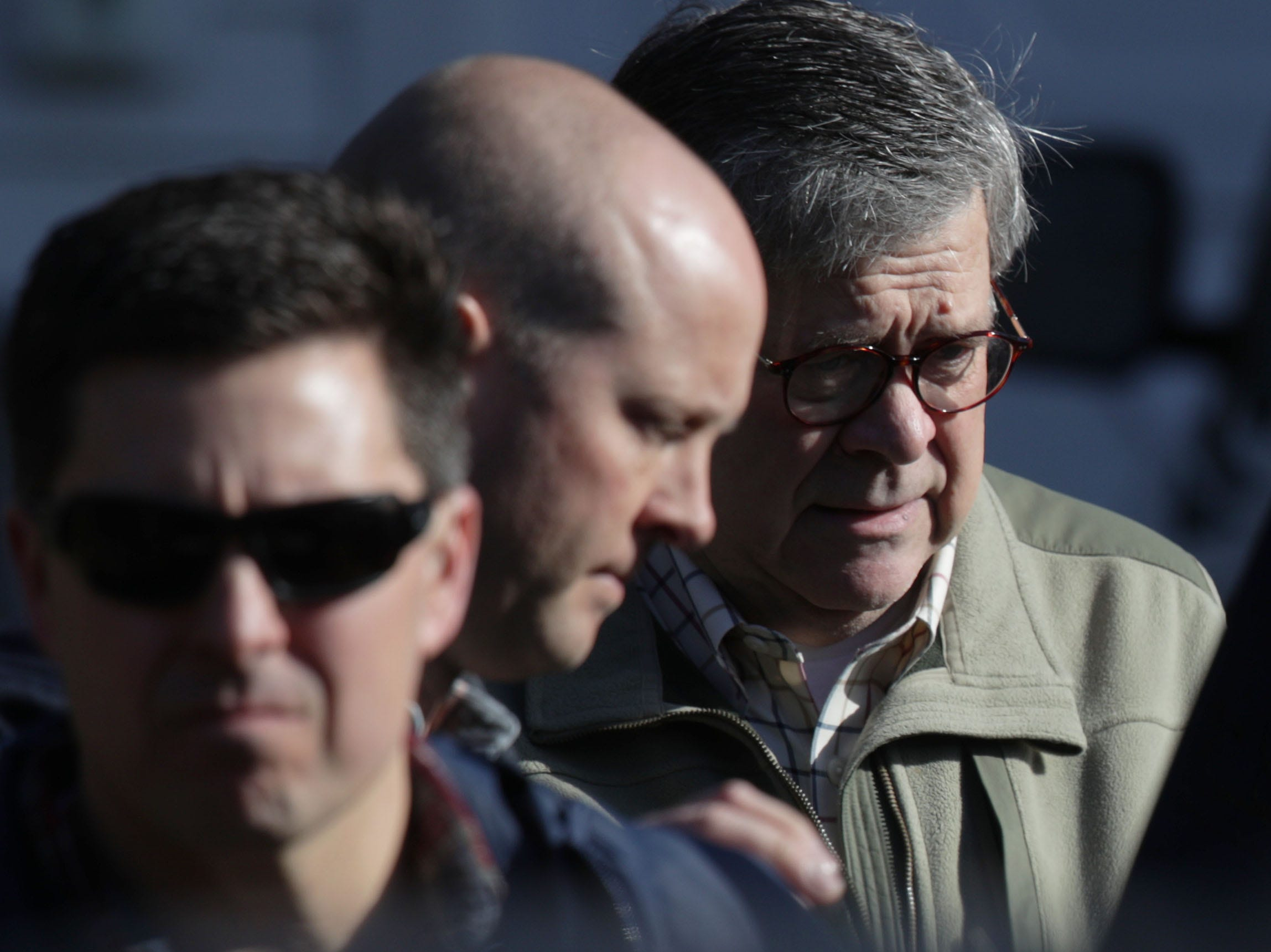 U.S. Attorney General William Barr, right, leaves his house on March 24, 2019 in McLean, Va. Barr continues to review special counsel Robert Mueller's report on alleged Russian meddling in the 2016 presidential election.