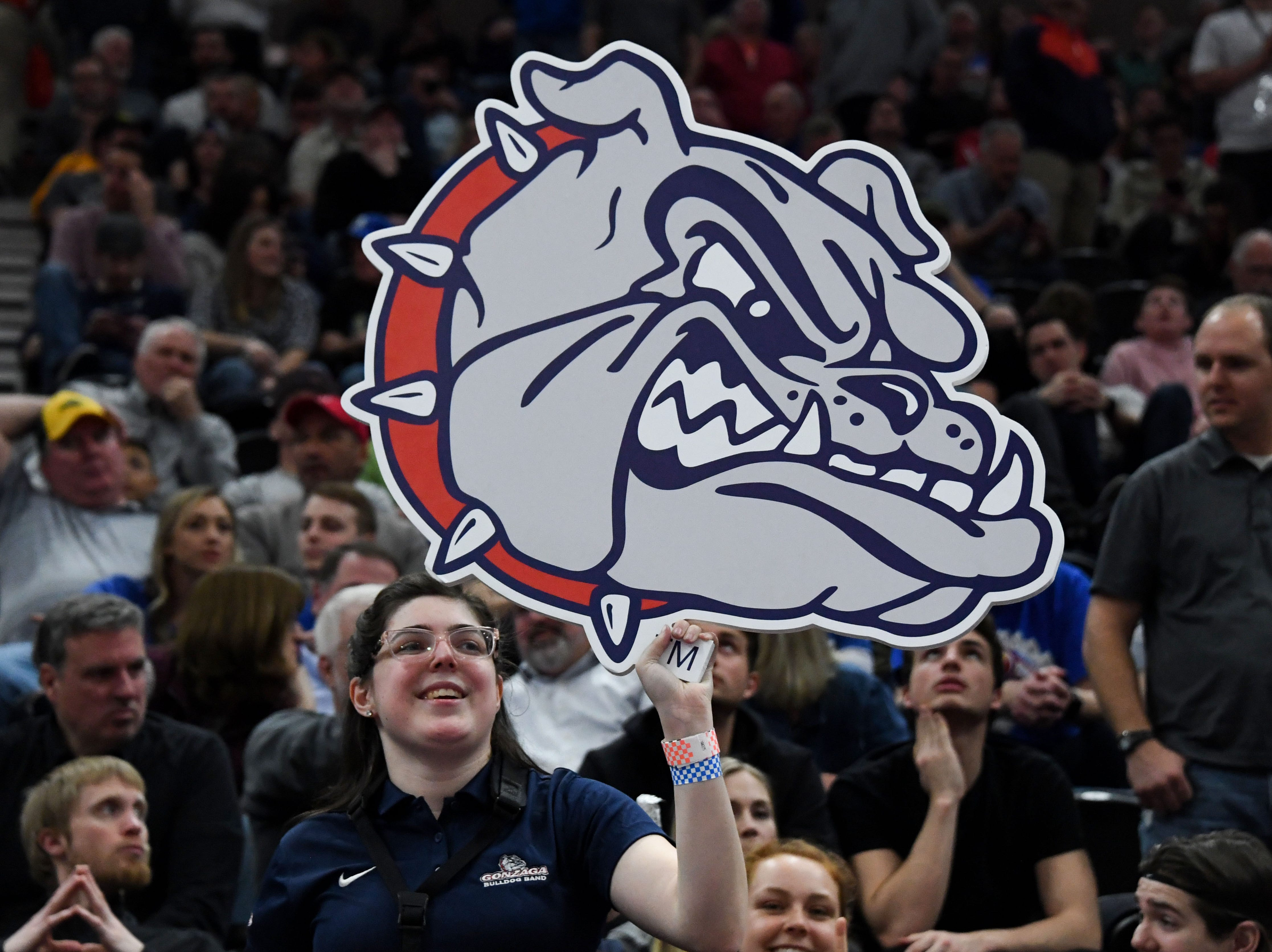 Round of 32: A Gonzaga fan holds up a Bulldogs sign during a game against the Baylor Bears.