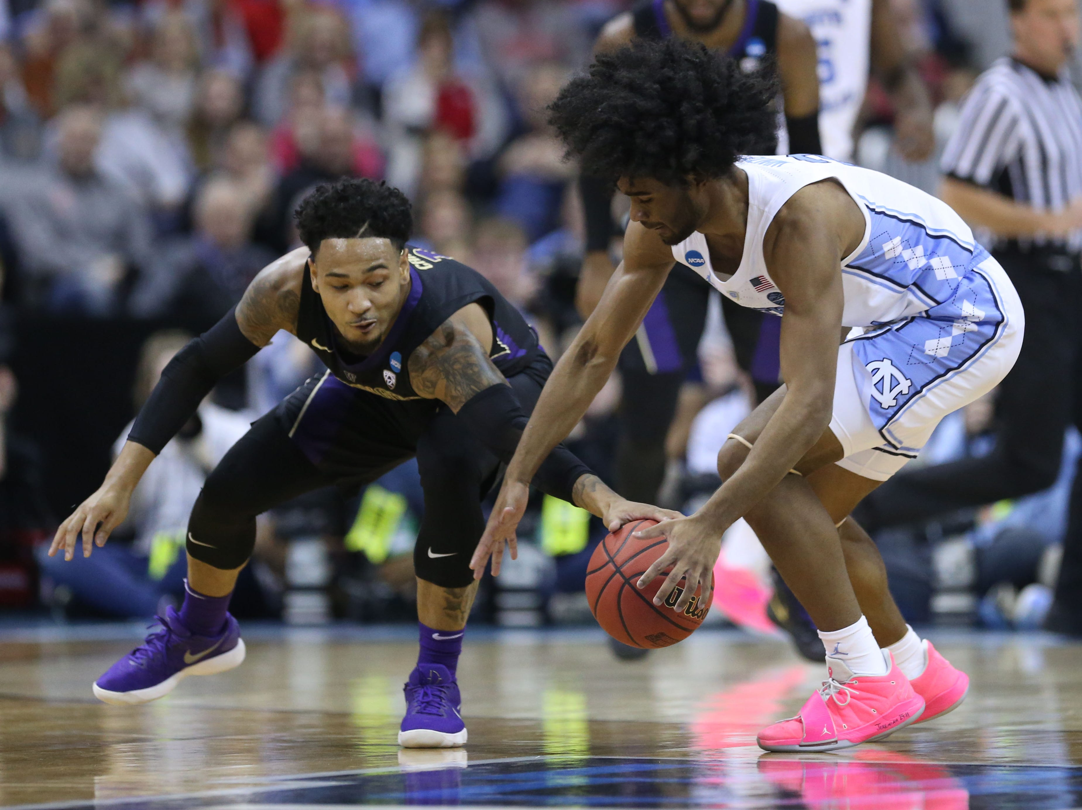 Round of 32: Washington guard David Crisp knocks the ball away from North Carolina guard Coby White.