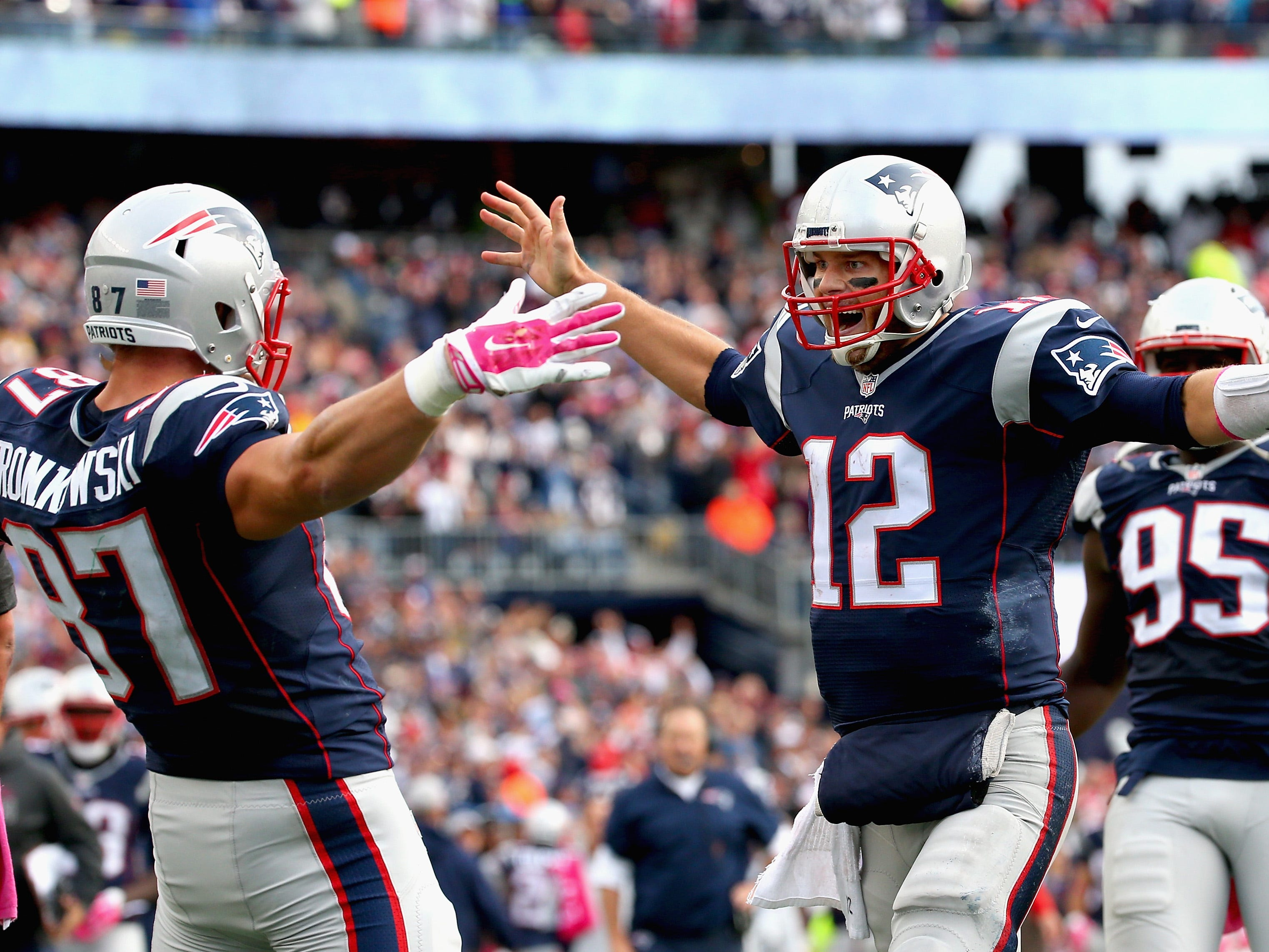 Oct. 25, 2015: Tom Brady and Rob Gronkowski react after Gronkowski scored a touchdown during the fourth quarter against the New York Jets at Gillette Stadium.