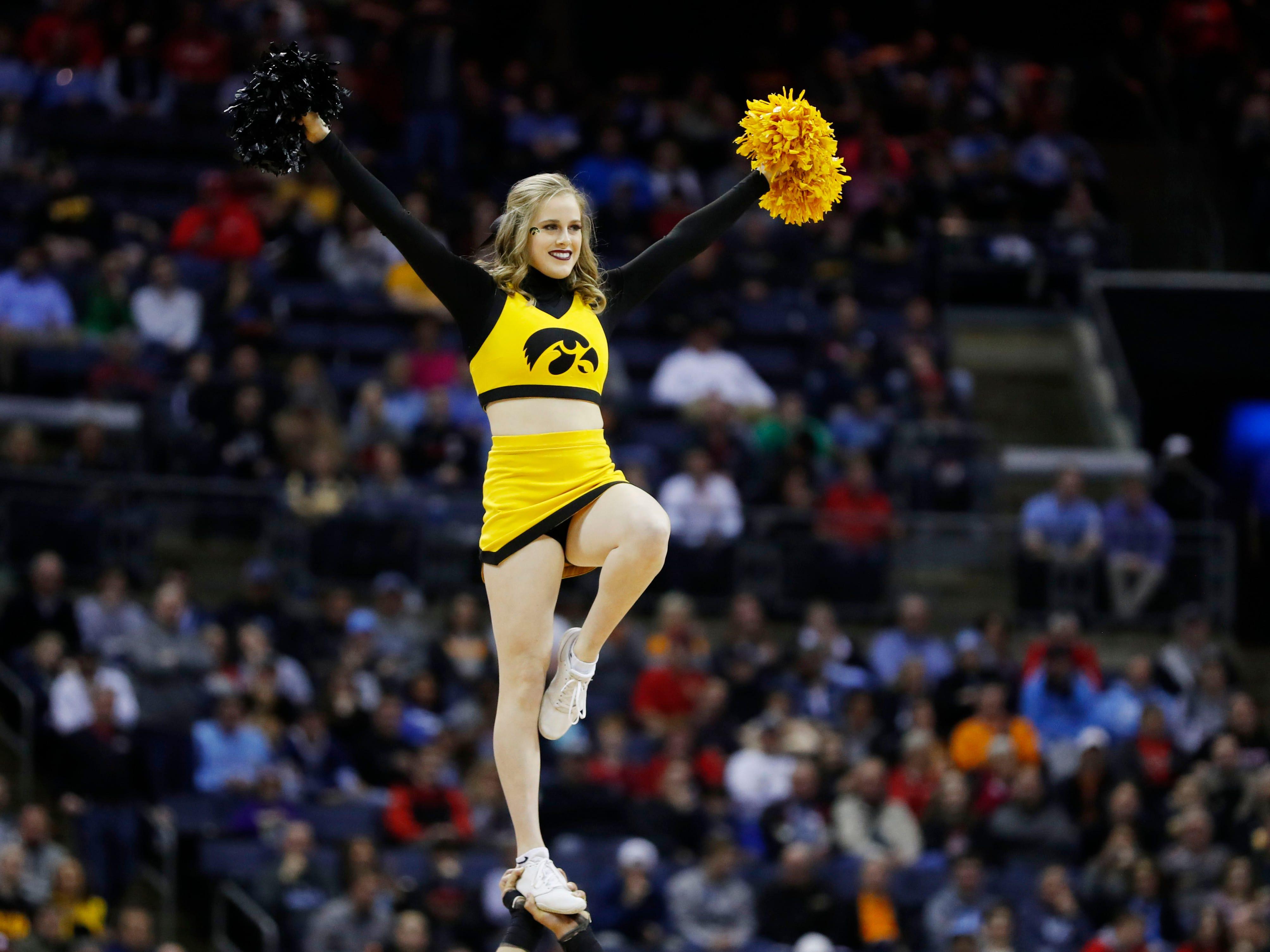 Round of 32: Hawkeyes cheerleader in the first half.