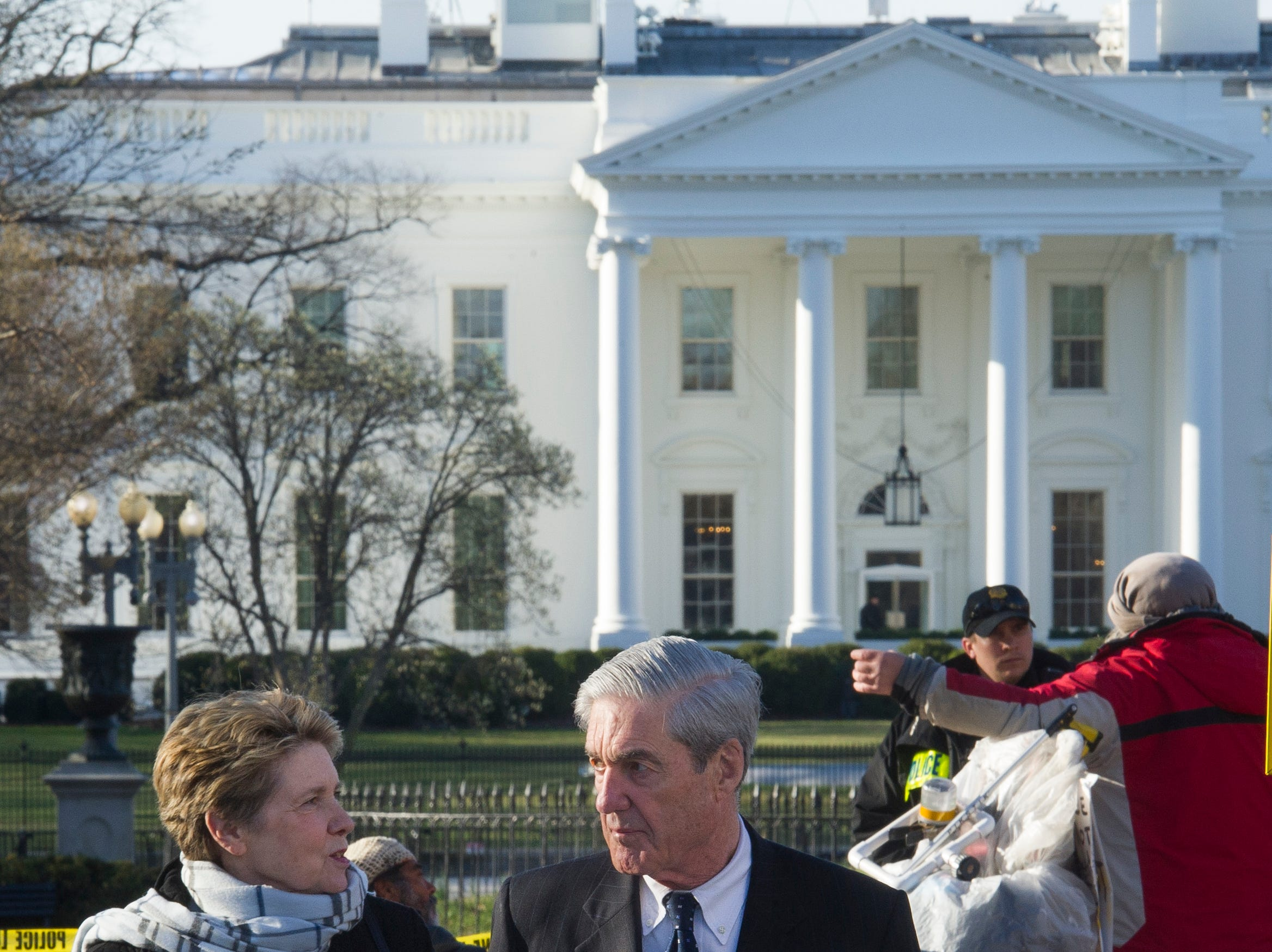 Robert Mueller, and his wife Ann, walk past the White House, after attending St. John's Episcopal Church for morning services on March 24, 2019 in Washington.