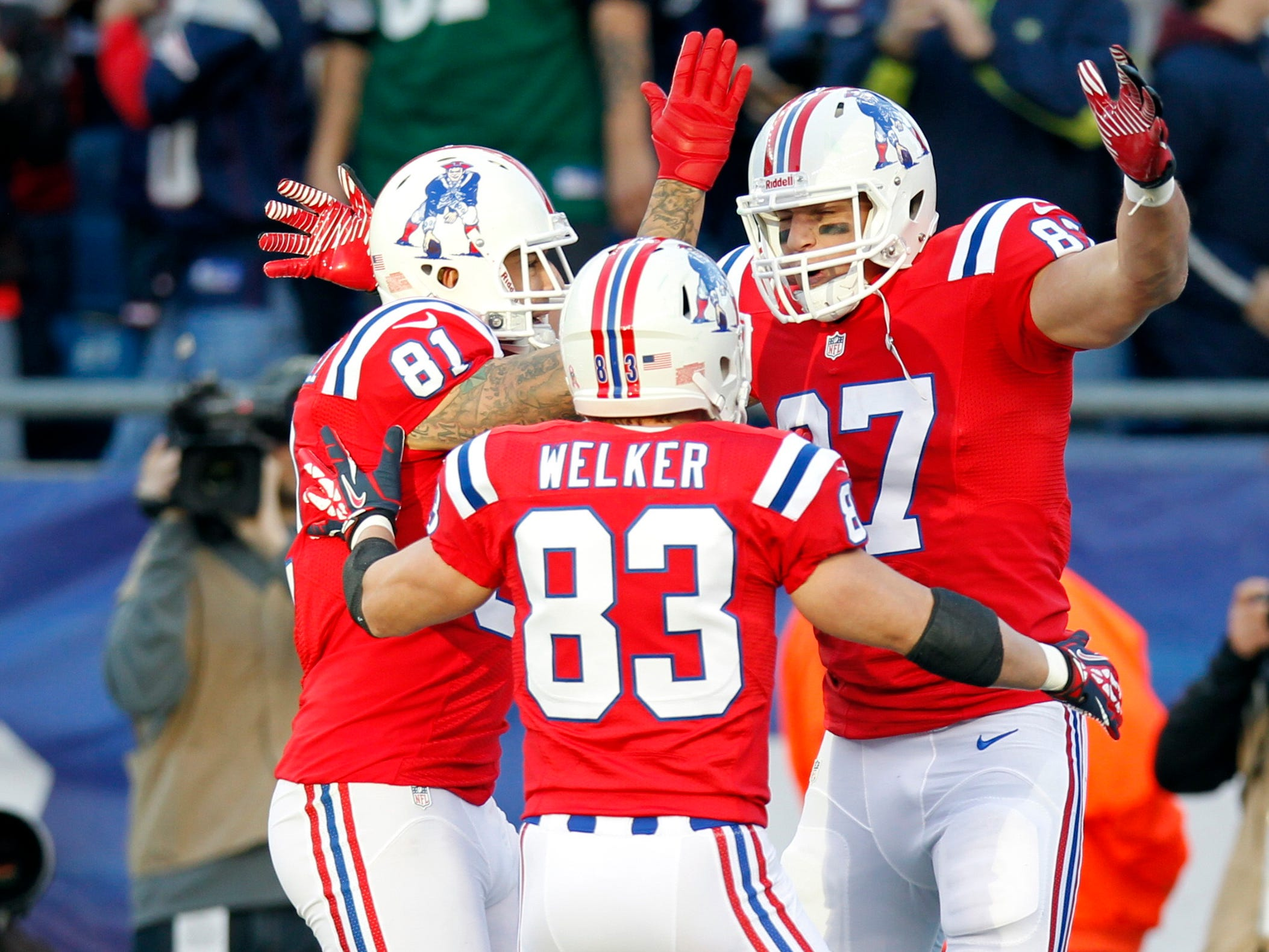 Oct. 21, 2012: Rob Gronkowski is congratulated by tight end Aaron Hernandez (81) and wide receiver Wes Welker (83) after scoring a touchdown during the first quarter against the New York Jets at Gillette Stadium.