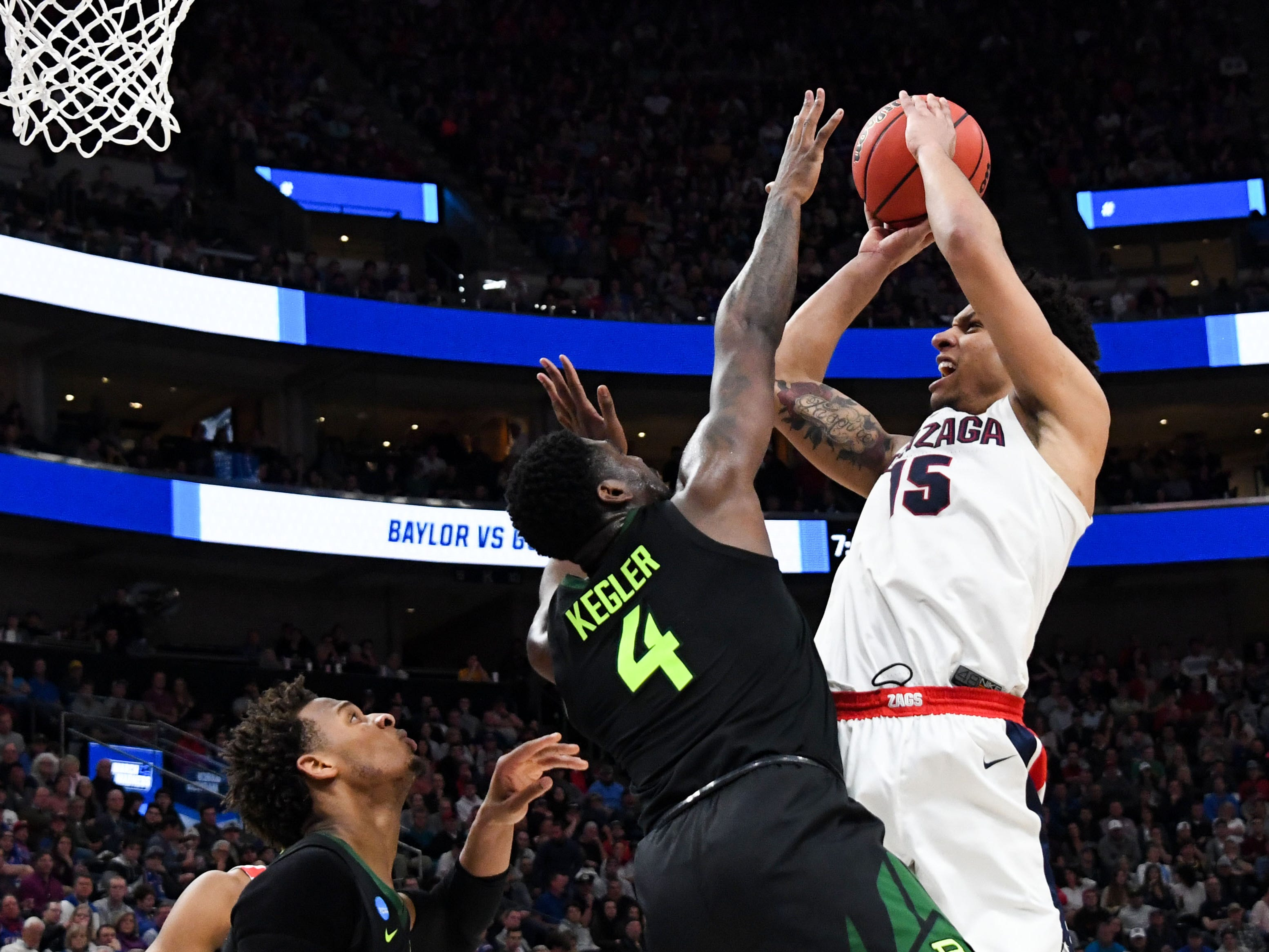 Round of 32: Gonzaga forward Brandon Clarke goes up for a shot on Baylor guard Mario Kegler. Clarke had 36 points in the Bulldogs' 83-71 win against the Bears.