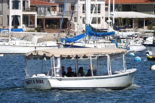 The electric Duffy boats line the Newport Beach Hartbor, home to multi-million dollar waterfront homes. The Duffys, which sell for $10,000 to $30,000, are also available for rent. Come join us on a photo cruise of the Hartbor, and let's explore Newport Beach as well.