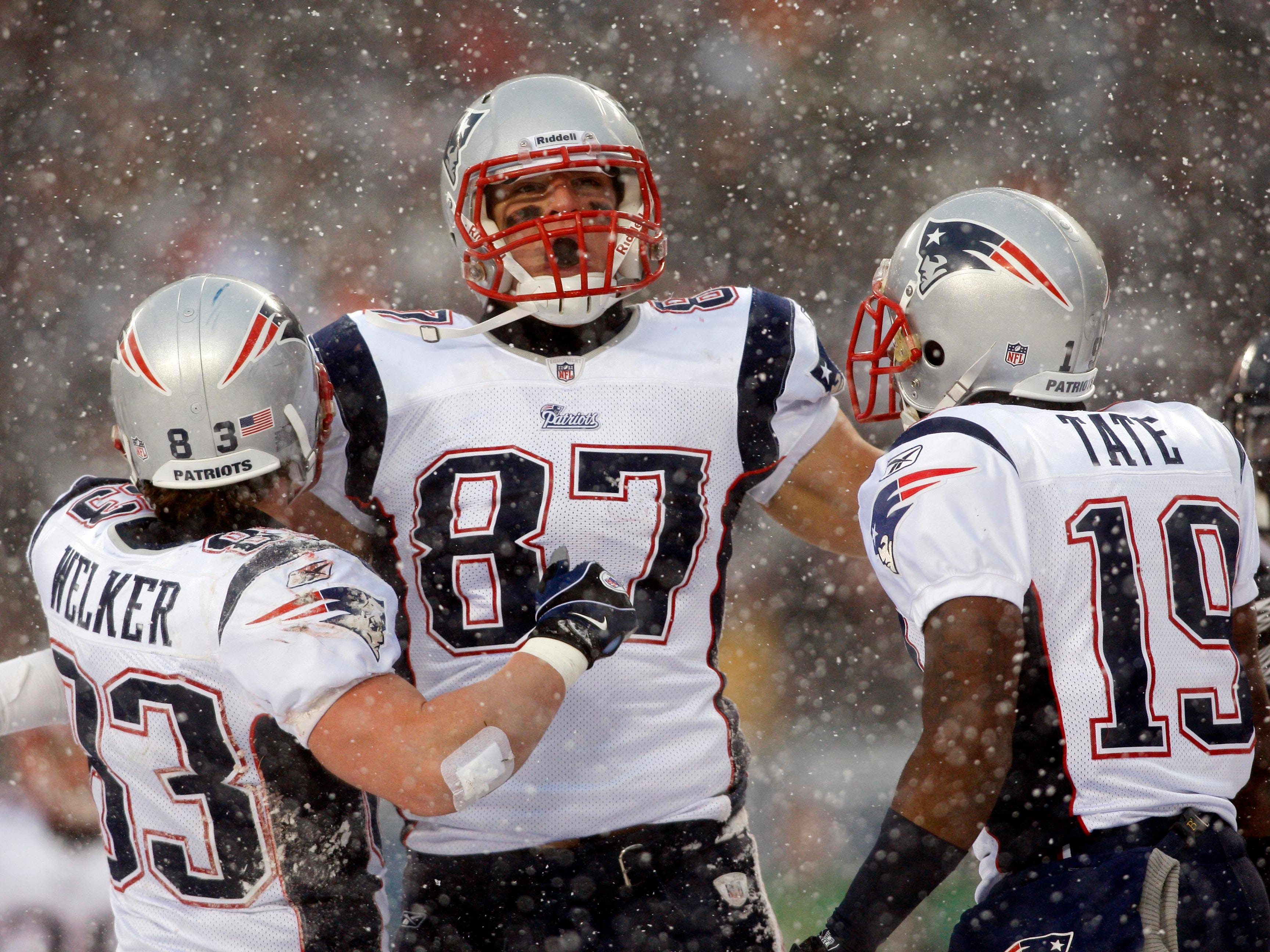 Dec. 12, 2010: Rob Gronkowski celebrates with teammates Wes Welker (83) and Brandon Tate (19) after scoring a touchdown against the Chicago Bears at Soldier Field.