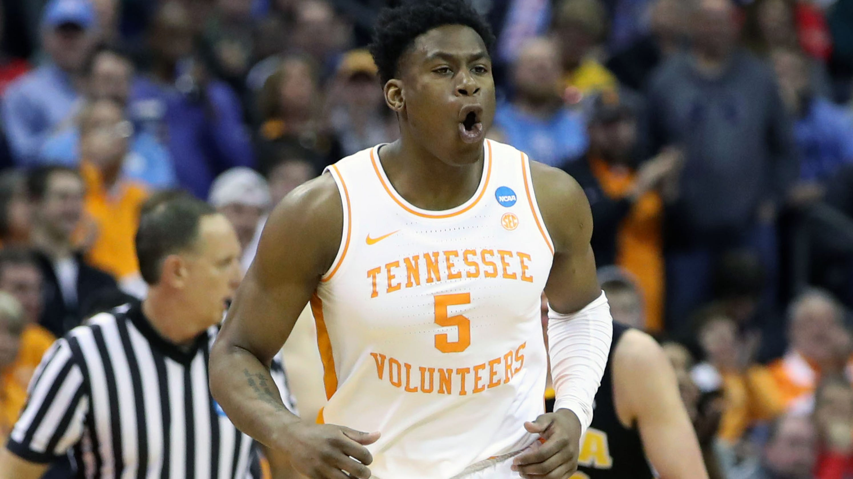 Tennessee blows 25-point lead and then survives Iowa in overtime to reach NCAA Sweet 16