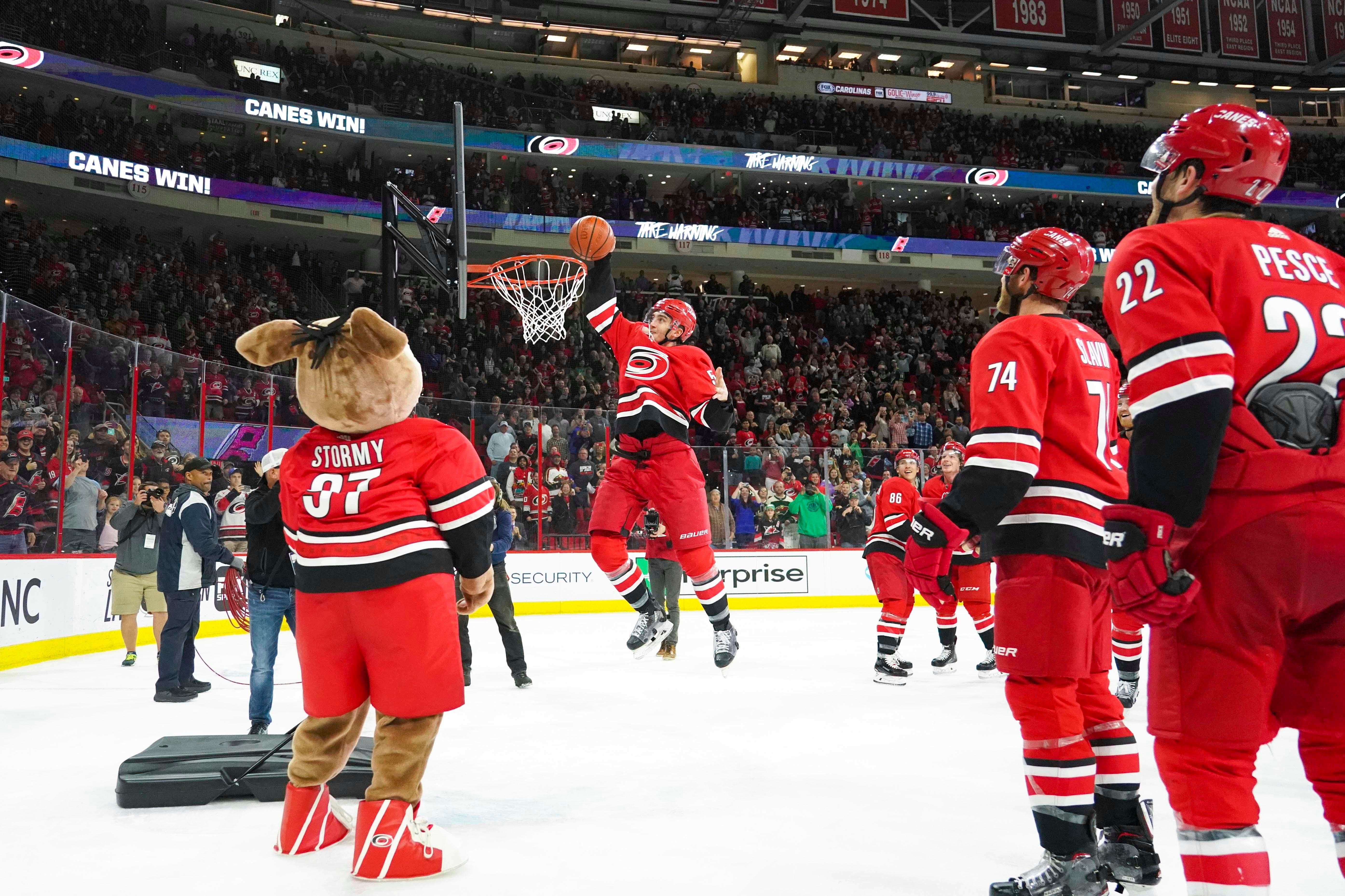 March Madness on skates: Carolina Hurricanes celebrate victory with a slam dunk