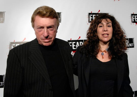This October 30, 2006, photo shows author, director Larry Cohen and wife Cynthia Cohen arrive at Comcast, Sony and the Lionsgate launch party for FEARnet, a multi-platform network dedicated to horror, held at Boulevard 3 nightclub in Los Angeles. Cohen, maverick B film director of cult horror film