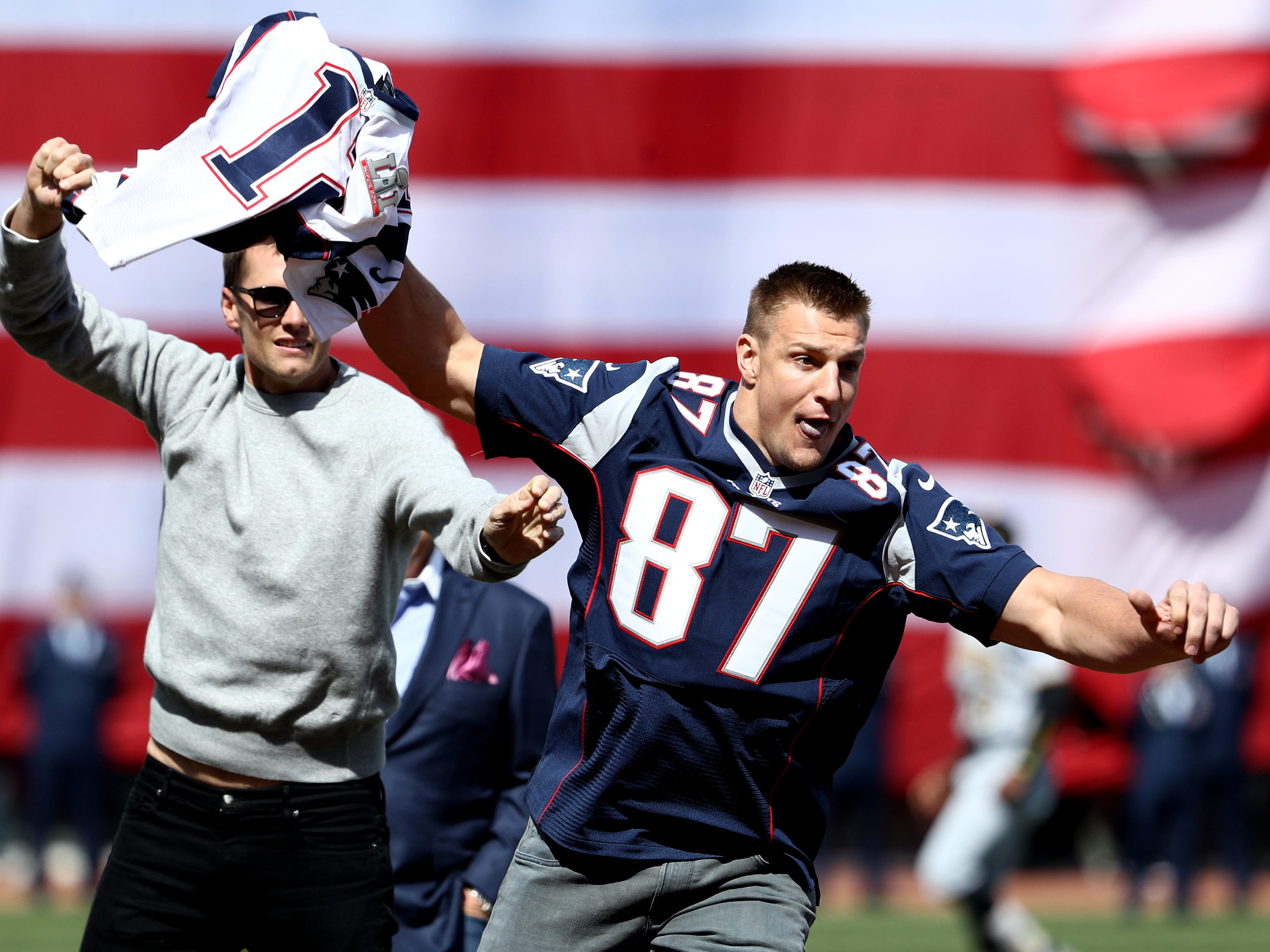 April 3, 2017: Rob Gronkowski of the  steals Tom Brady's jersey before the opening day game between the Boston Red Sox and the Pittsburgh Pirates at Fenway Park.