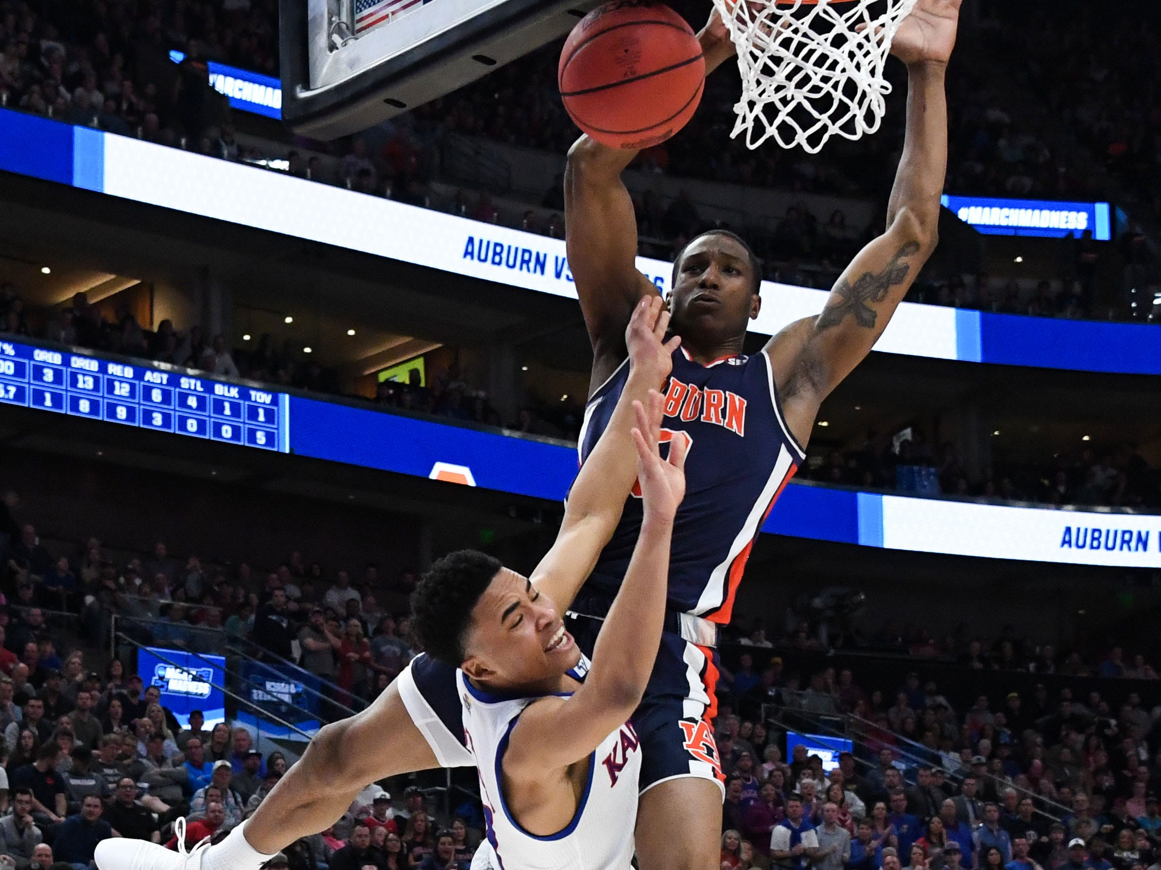 Round of 32: Auburn Tigers forward Horace Spencer blocks a shot by Kansas Jayhawks guard Devon Dotson.