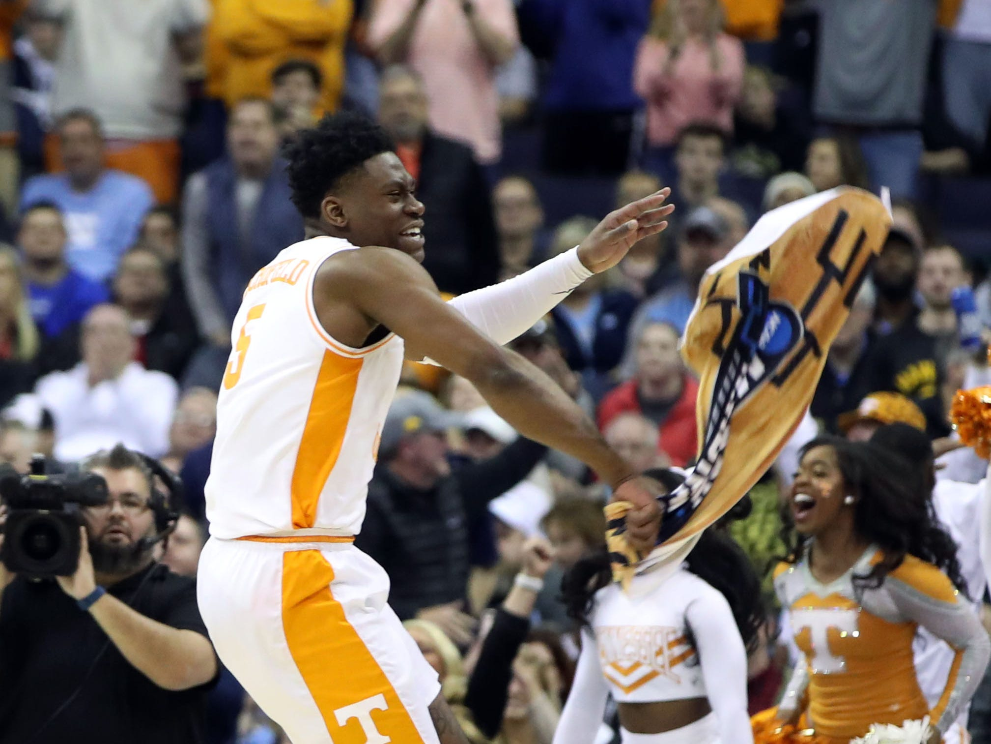 Round of 32: Volunteers guard Admiral Schofield celebrates after surviving a furious comeback attempt by the Hawkeyes that went into overtime.