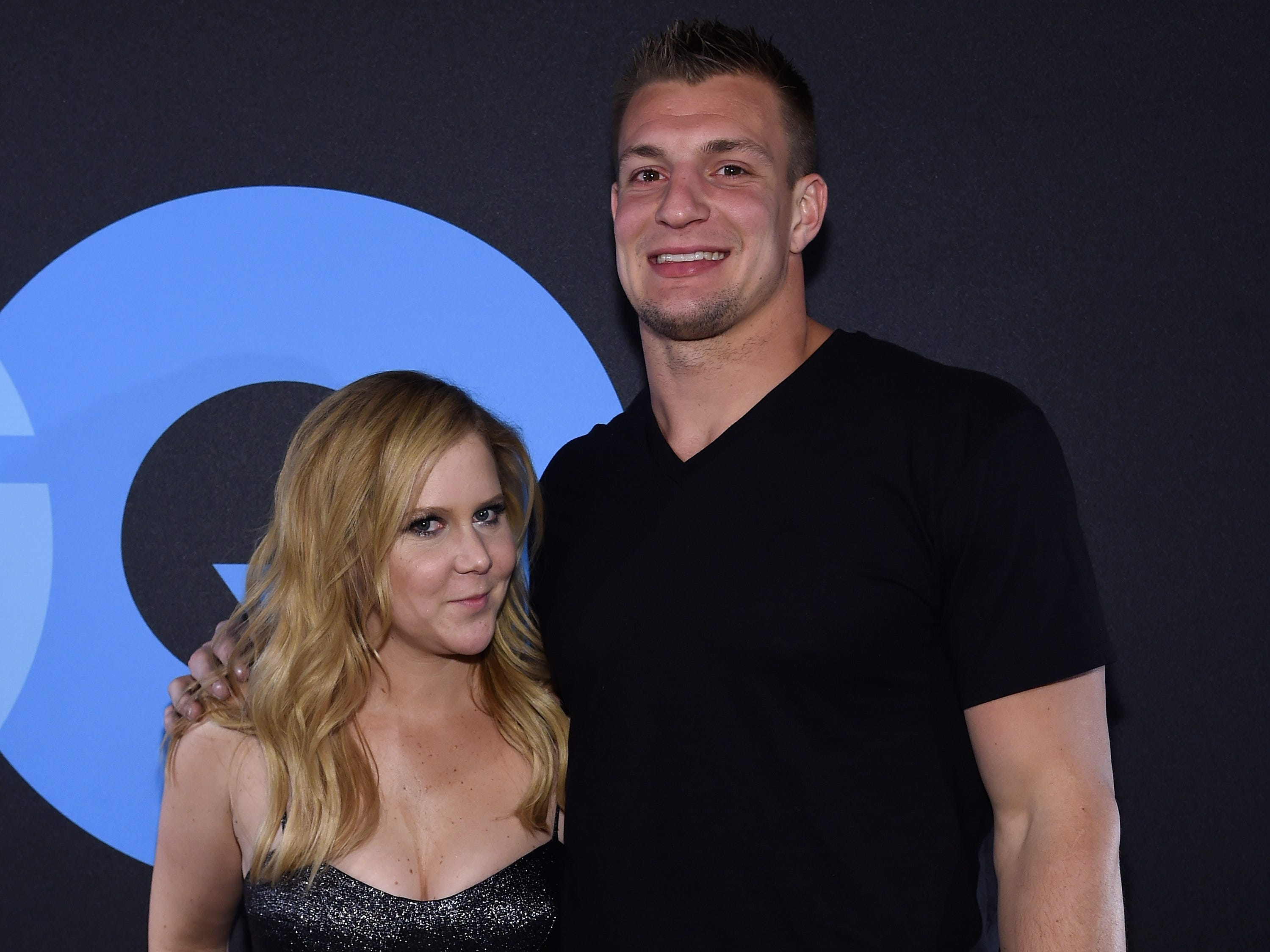 Feb. 14, 2015: Comedian Amy Schumer and Rob Gronkowski attend GQ and LeBron James Celebrate All-Star Style in New York City.