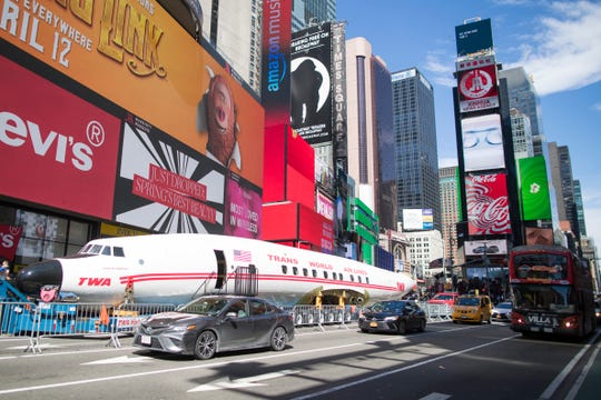 """A Lockheed Constellation L-1649A Starliner, known as the """"Connie,"""" is parked in New York's Times Square during a promotional event on March 23, 2019, in New York."""