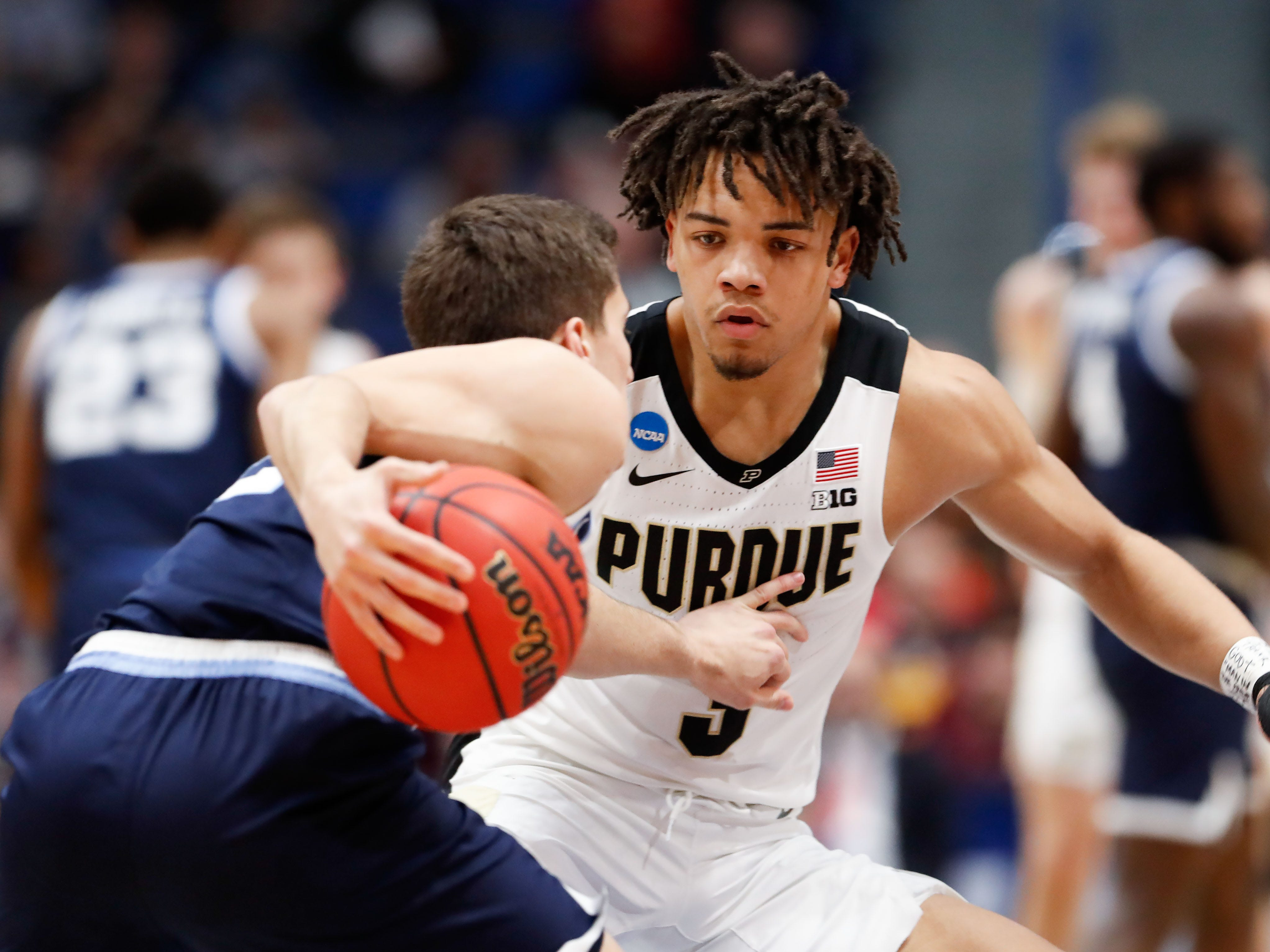 Round of 32: Purdue Boilermakers guard Carsen Edwards defends Villanova Wildcats guard Collin Gillespie.