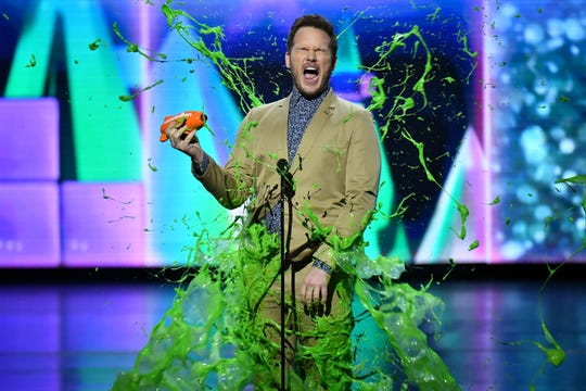 """Chris Pratt won an orange blimp as favorite butt-kicker for his role as Owen Grady on """"Jurassic World: Fallen Kingdom"""" – and earned some slime of his own –at the Kids' Choice Awards on March 23."""