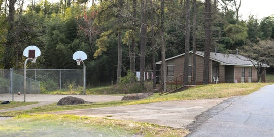 An empty basketball court and Liberty apartments along Brookmeade Drive in Anderson Sunday, March 24, 2019. A 28-year old man is wanted for attempted murder after injuring two adults and leaving four children uninjured upon shooting toward a car Saturday night, according to a warrant from the city police department.