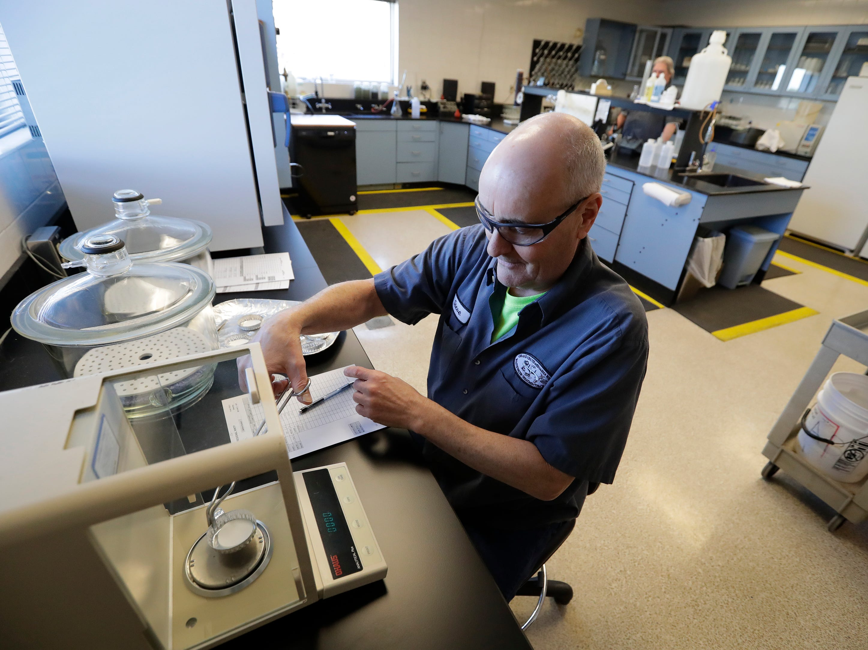 Lab director Steven Vickstrom evaluates solids concentrations for compliance purposes at th Fox West Regional Wastweater Treatment Plant located at 1965 W. Butte des Morts Beach Road Tuesday, March 19, 2019, in Fox Crossing, Wis. Dan Powers/USA TODAY NETWORK-Wisconsin