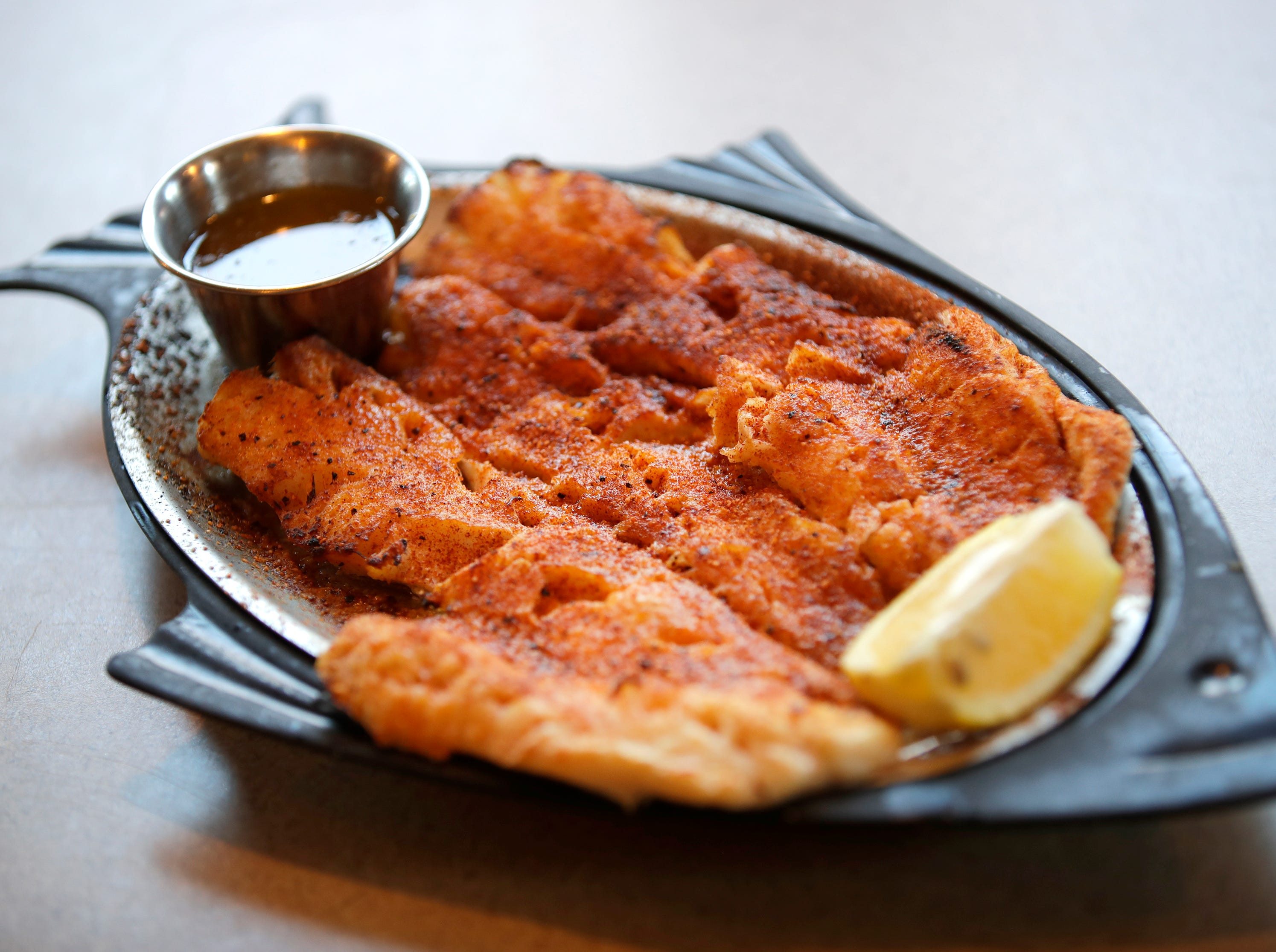 Black Otter Supper Club's Cajun broiled haddock Thursday, March 21, 2019, in Hortonville, Wis. 
