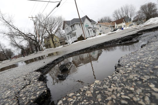 A pothole at the intersection of East Pacific Street and North Meade Street in Appleton.