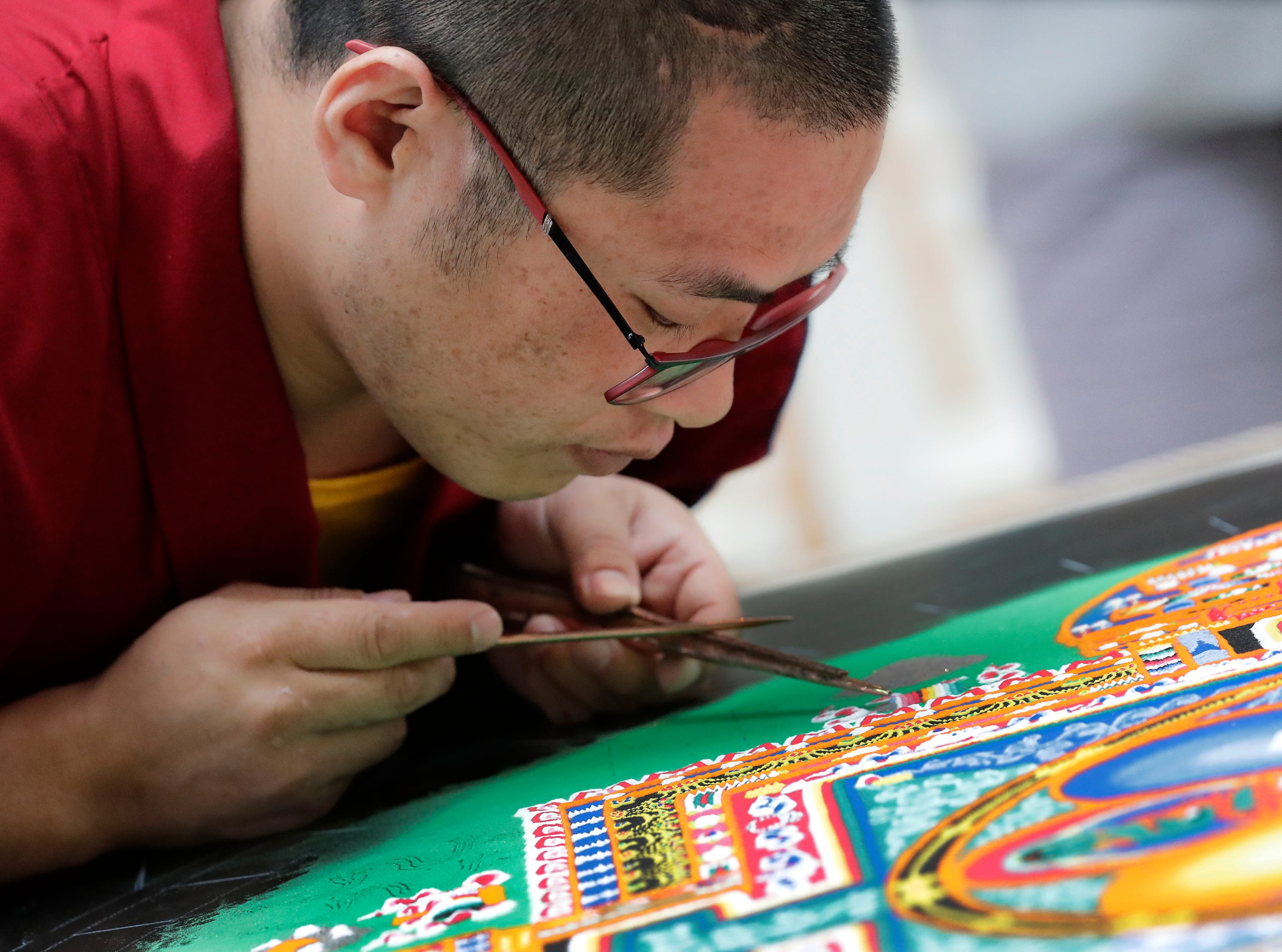 Lobsang Tharchin, a Buddhist monk from Drepung Loseling Monastery in south India, uses a Chak-pur to create a Mandala Thursday Thursday, March 21, 2019, at The Paine Art Center and Gardens in Oshkosh, Wis. Dan Powers/USA TODAY NETWORK-Wisconsin