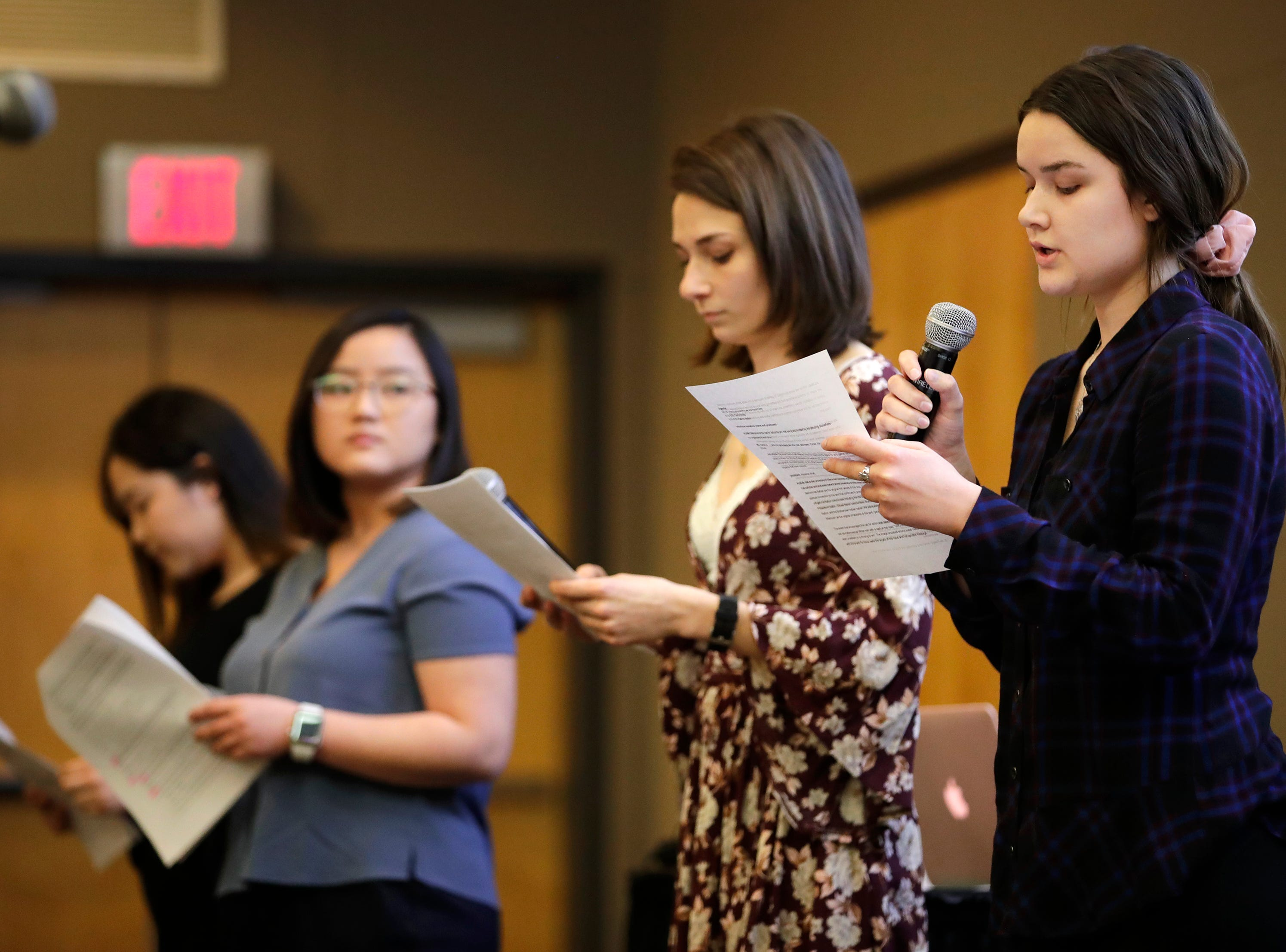Call for Action Forum organizers from left Pa Houa Xiong, Alina Xiong, Alicia Obermeier, and Hannah Johnson introduce themselves to the crowd during the forum in the Reeve Union at the University of Wisconsin-Oshkosh Monday, March 18, 2019, in Oshkosh, Wis. Danny Damiani/USA TODAY NETWORK-Wisconsin