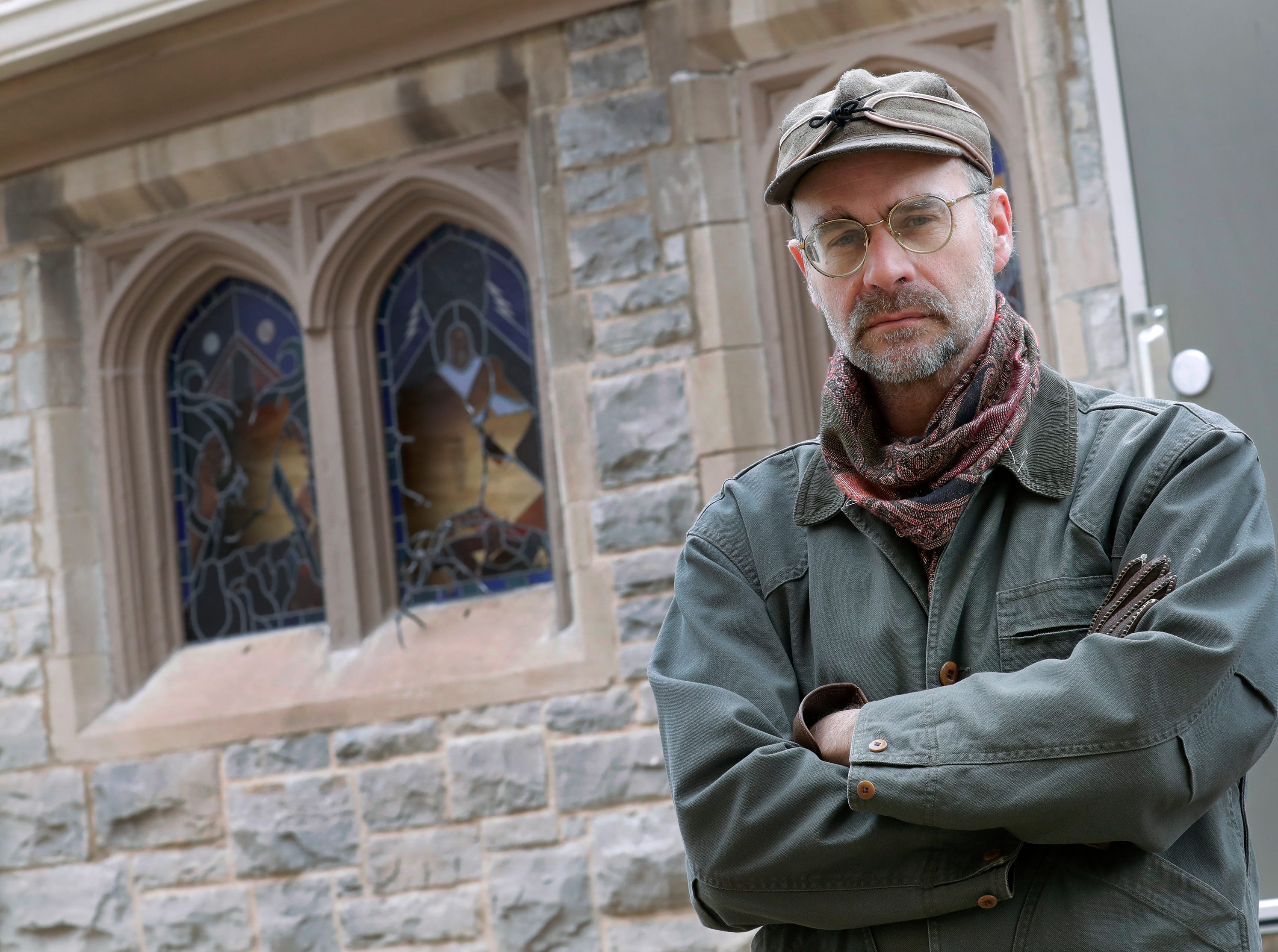 Senior warden Rob Anderson stands in front of vandalized stained glass windows Wednesday, March 20, 2019, at All Saints Episcopal Church in Appleton, Wis. Dan Powers/USA TODAY NETWORK-Wisconsin