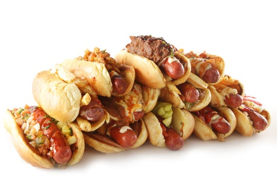 """A """"tower"""" of dogs from Tower Dogs, opening soon on the Asbury Park boardwalk. The beef hot dogs are served on toasted buns and topped with housemade toppings and sauces."""