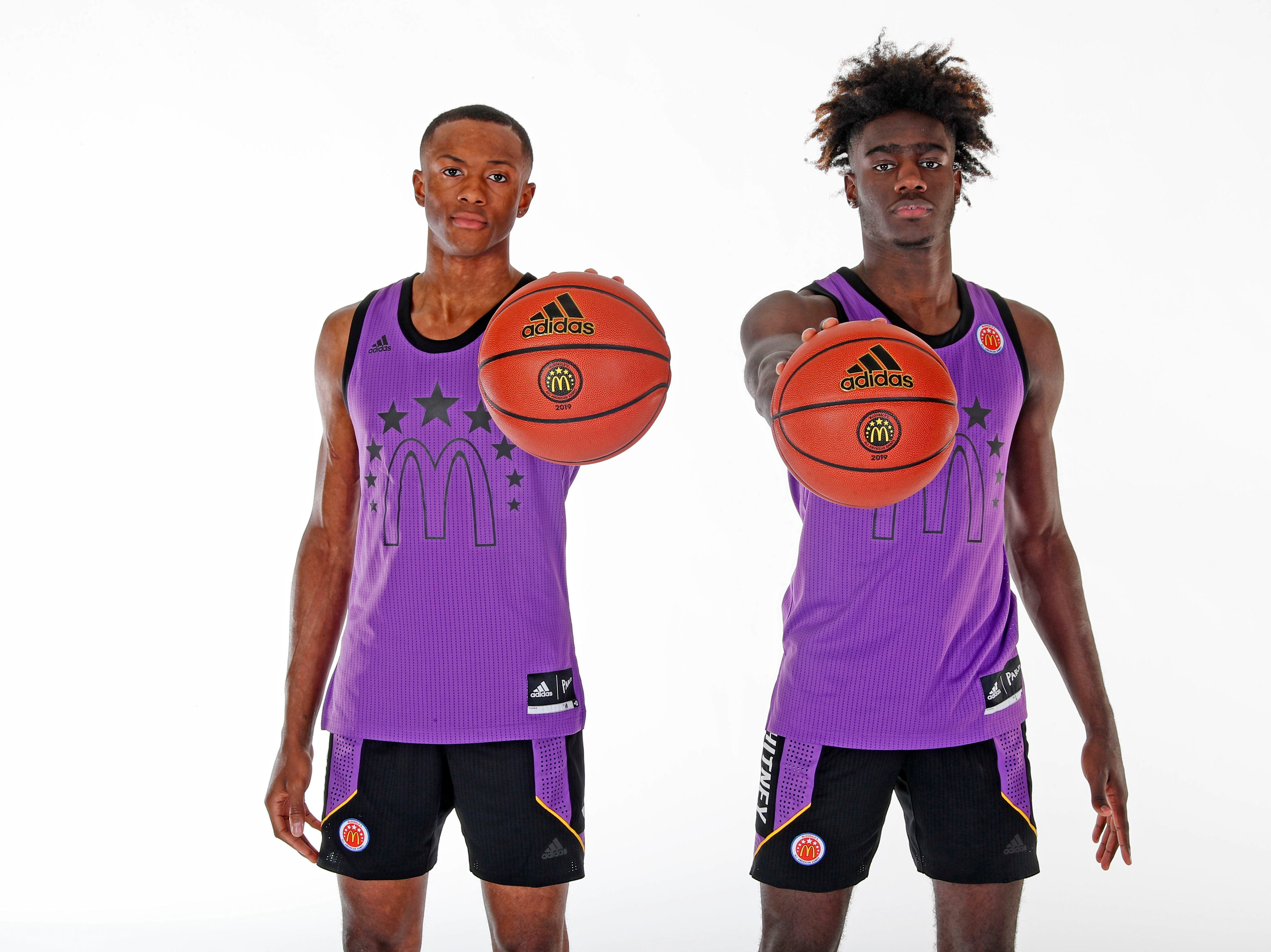 Mar 23, 2019; Atlanta, GA, USA; From left to right McDonalds High School All American forward Kahlil Whitney (2) and guard Scottie Lewis (23) who are both from the state of New Jersey pose for a group photo on portrait day at the Hilton Hotel Crystal Ball Room before the 2019 McDonalds All American Game. Mandatory Credit: Brian Spurlock-McDonalds