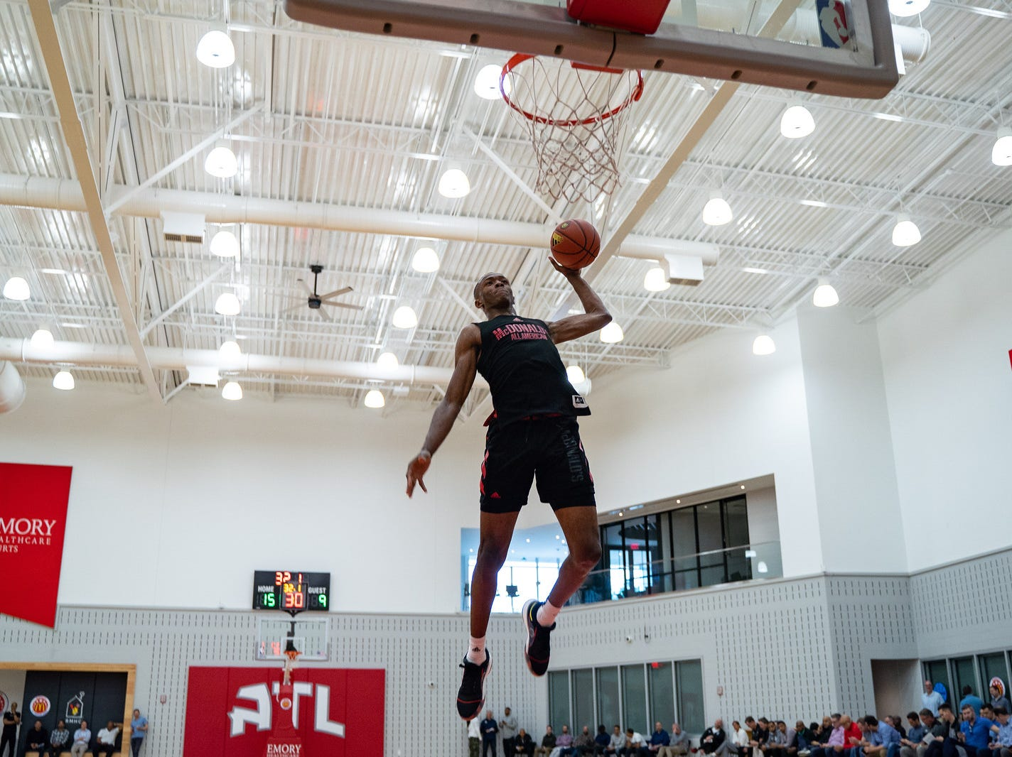 Scottie Lewis goes up for a dunk at McDonald's All-American Game practice on Sunday