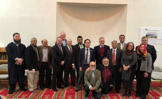 Clergy and distinguished guests at the Islamic Center of Ocean County pose for a group photo on the night of March 22, 2019.