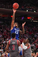 Seton Hall Pirates guard Myles Powell (13) shoots over St. John's Red Storm guard Shamorie Ponds (2)