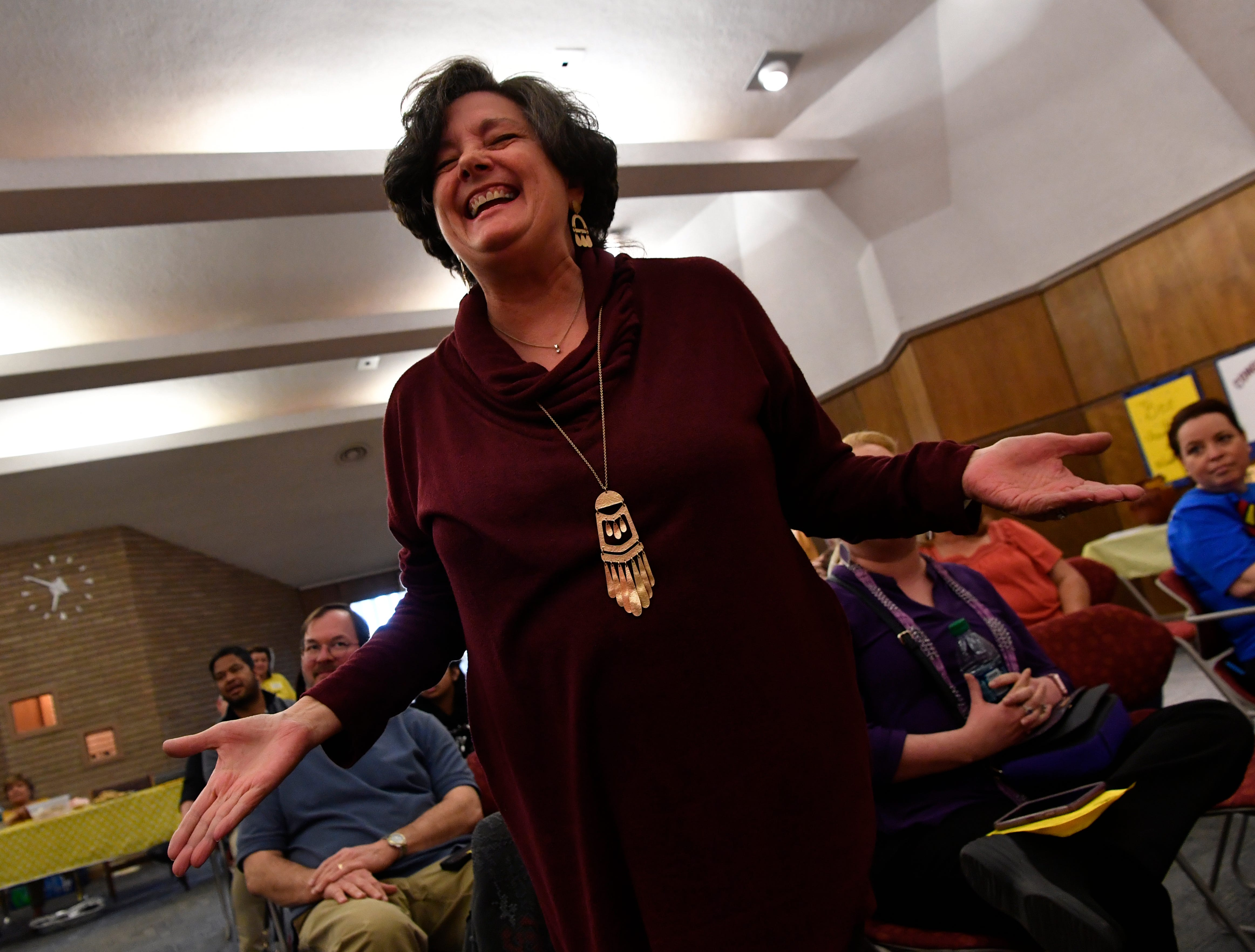 """Between rounds, audience members at SpellAbilene were invited to spell words for prizes . After at least two other spelled it wrong, Betty Hukill takes her turn to correctly spell """"cemetery."""""""