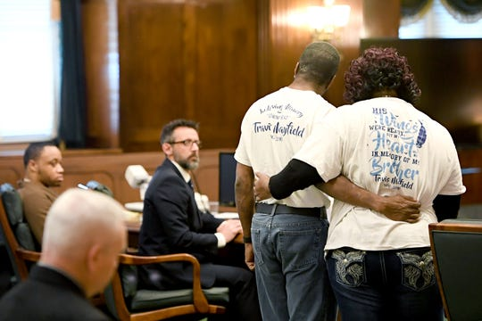 Travis Mayfield's family members comfort one another as they give victim statements during the plea hearing for Frederick Nathaniel Simpson and Travoscia Herbell Brown who pleaded guilty to voluntary manslaughter in the November 2016 shooting death of Mayfield at the Buncombe Count Courthouse on March 25, 2019.
