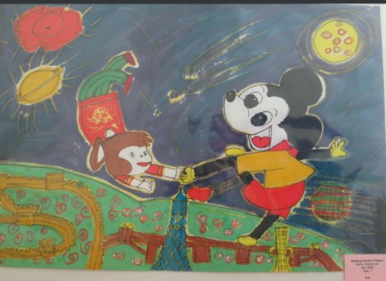 """""""Shaking Hands in Space,"""" created by 7-year-old Zhang Cao, depicts China's fabled Monkey King shaking hands with Mickey Mouse in space, right above the Great Wall of China. It is one of the original paintings sent from China to Michigan as part of the Michigan 4-H China Project."""