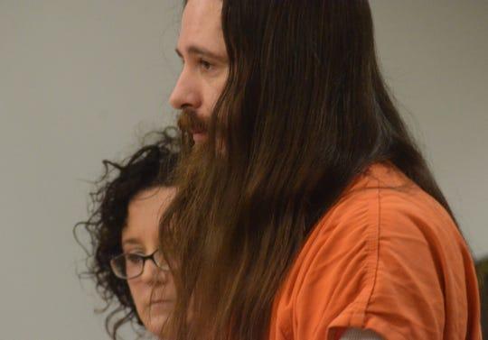 Matthew Toole with his attorney, Melissa Heffner.