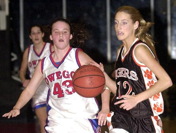 2002: Union-Endicott's Kelly Burnham, right, takes the ball toward the basket on a steal as Owego Free Academy's Michelle Reynolds, left, is close behind during Wed night's game.