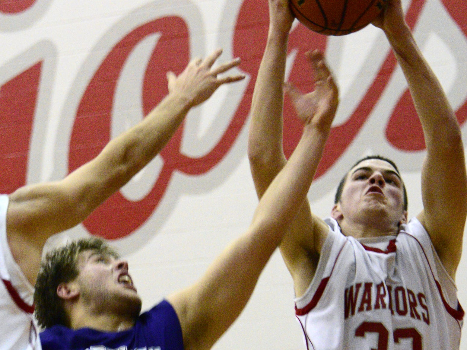2012: Chenango Valley's Zach Collins grabs the rebound in front of Norwich's Grant Brightman in the second half Wednesday night.