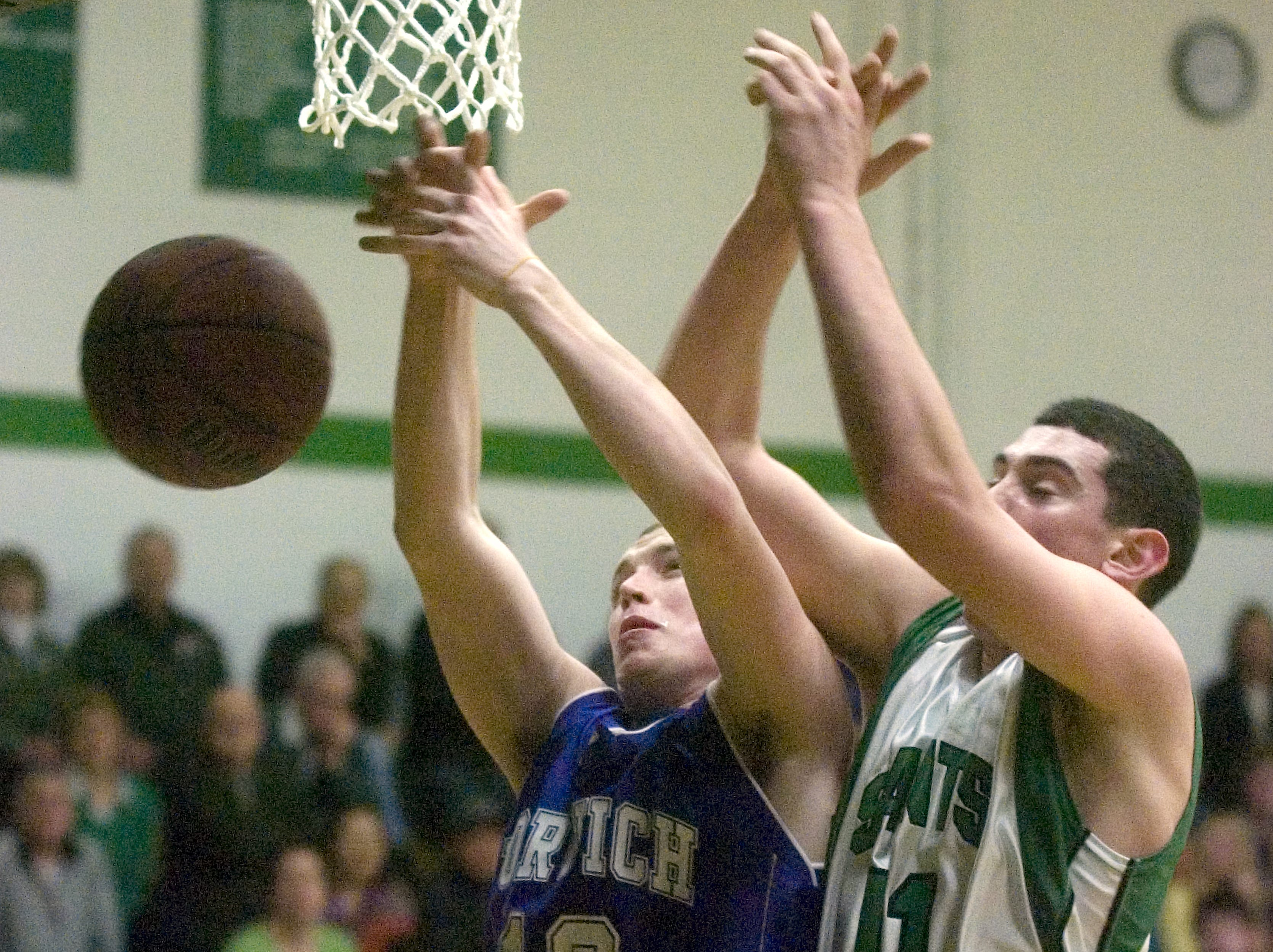 2009: Norwich's Corey Dietrich, left, and Seton Catholic Central's Tom Torto miss the ball on the rebound in the second quarter of Wednesday's game at Seton.
