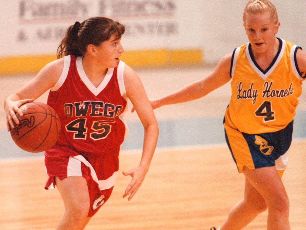 1997: Owego Free Academys #45 Courtney Hand dribbles around Harpursville #4 Kelly Criddle at John McCarthy Memorial Girls Basketball Tournament for MS held at the Broome County Veterans Memorial Arena on December 4-6th.
