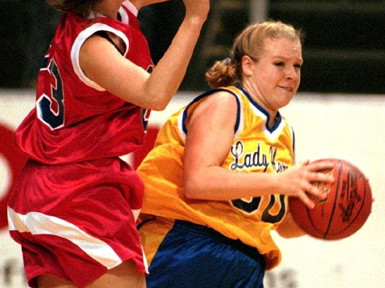 1997: Owego Free Academy's Magaret Gilligan, left, tries to block Harpursville's Erin McMahon, right, from passing to a teammate during opening round action from the John McCarthy Girls Basketball Tournament being held in the Broome County Veterans Memorial Arena thursday evening. Owego won the contest 55 to 25 over Harpursville.