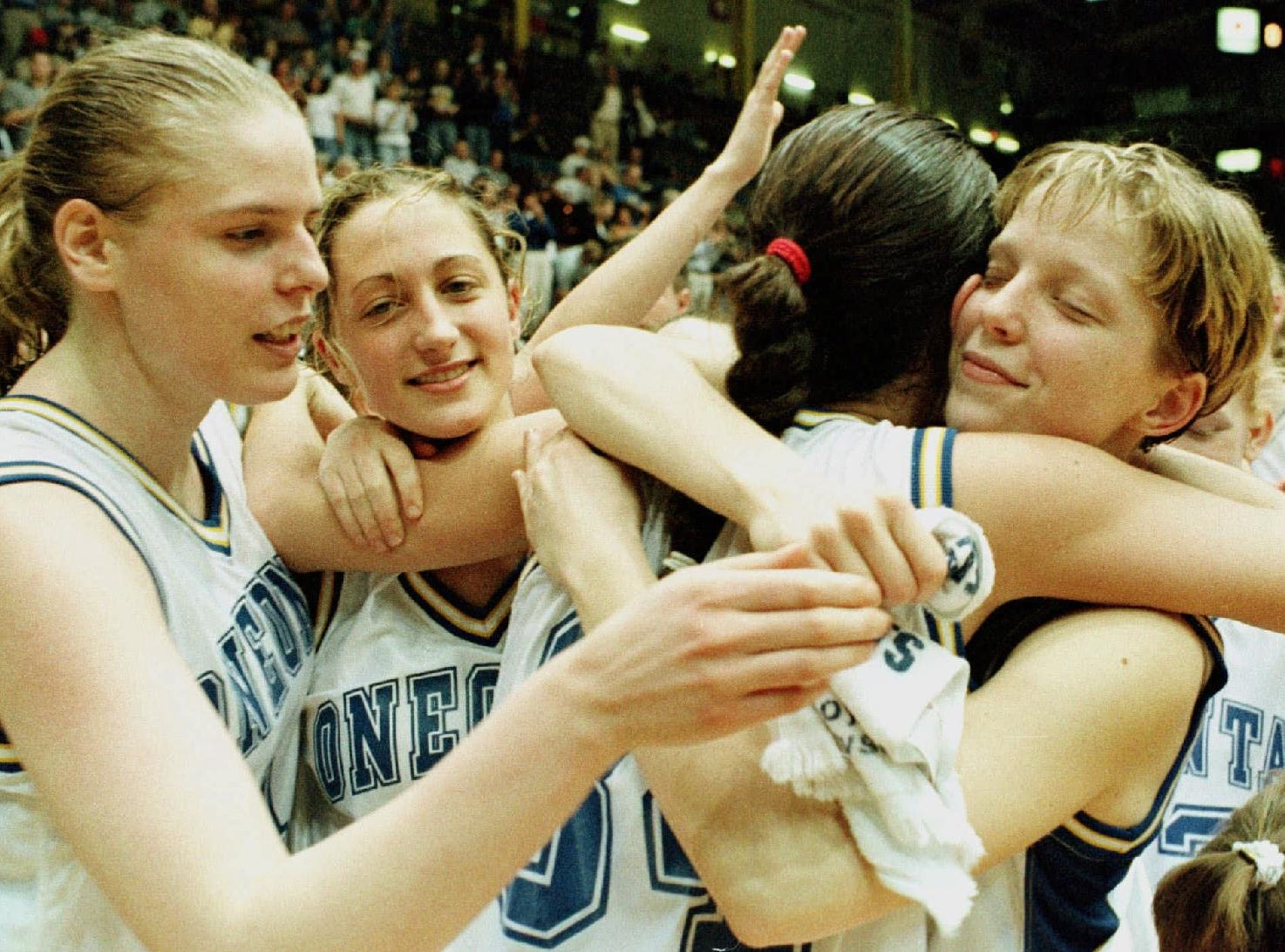 Oneonta's girl's team celebrates their 60-40 win over St. Domonic of Oyster Bay in the Federation Girls Class B Championship game Saturday, March 28, 1998, in Glens Falls, N.Y. The players are, from left: Stacy Knapp; Krissy Zeh; Tiffany Hurley; and Karyn Piece.